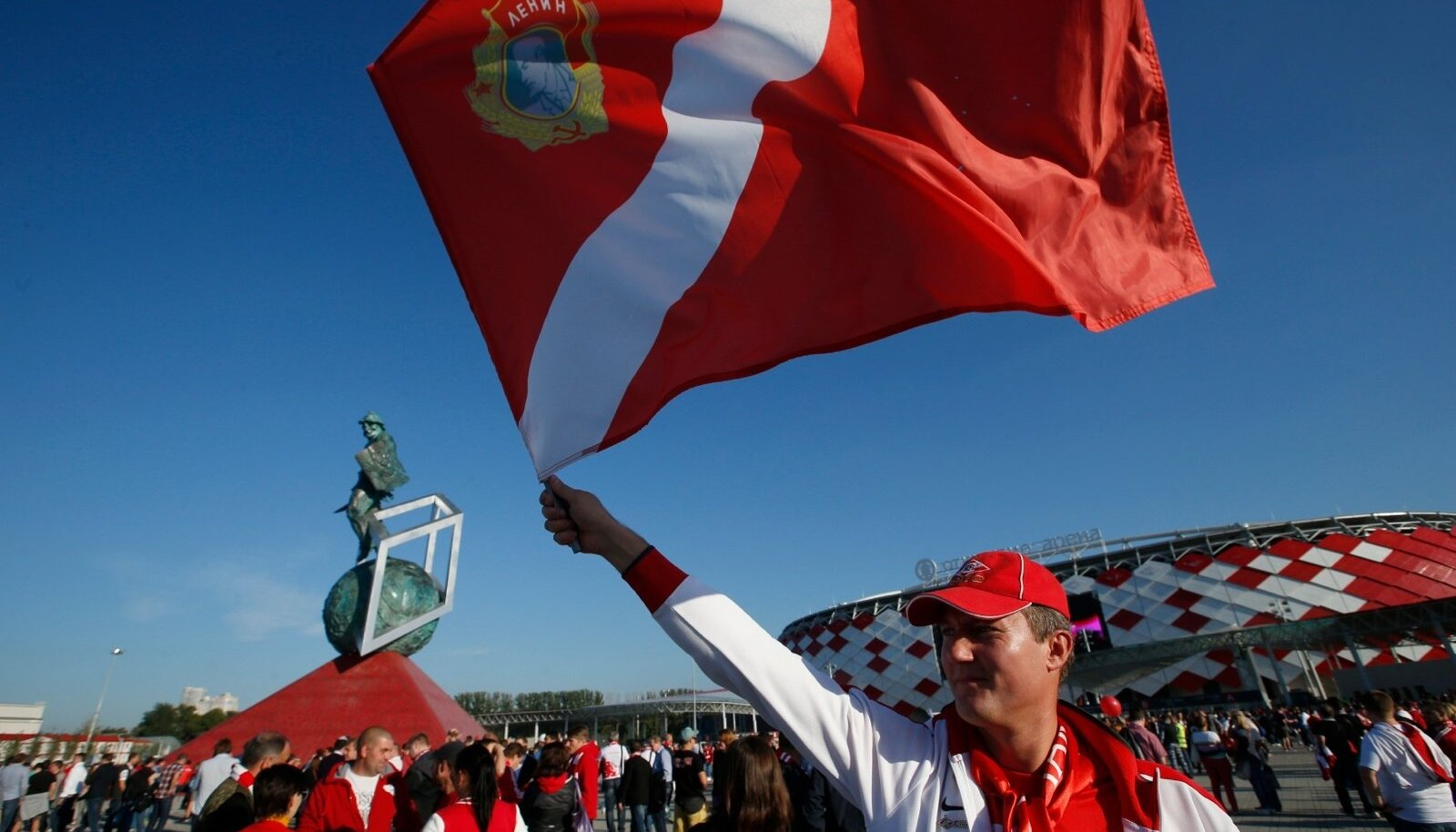 A Spartak fan waves a flag outside Otkrytie Arena stadium, before the team's warm-up soccer match against Belgrade's Red Star in Moscow