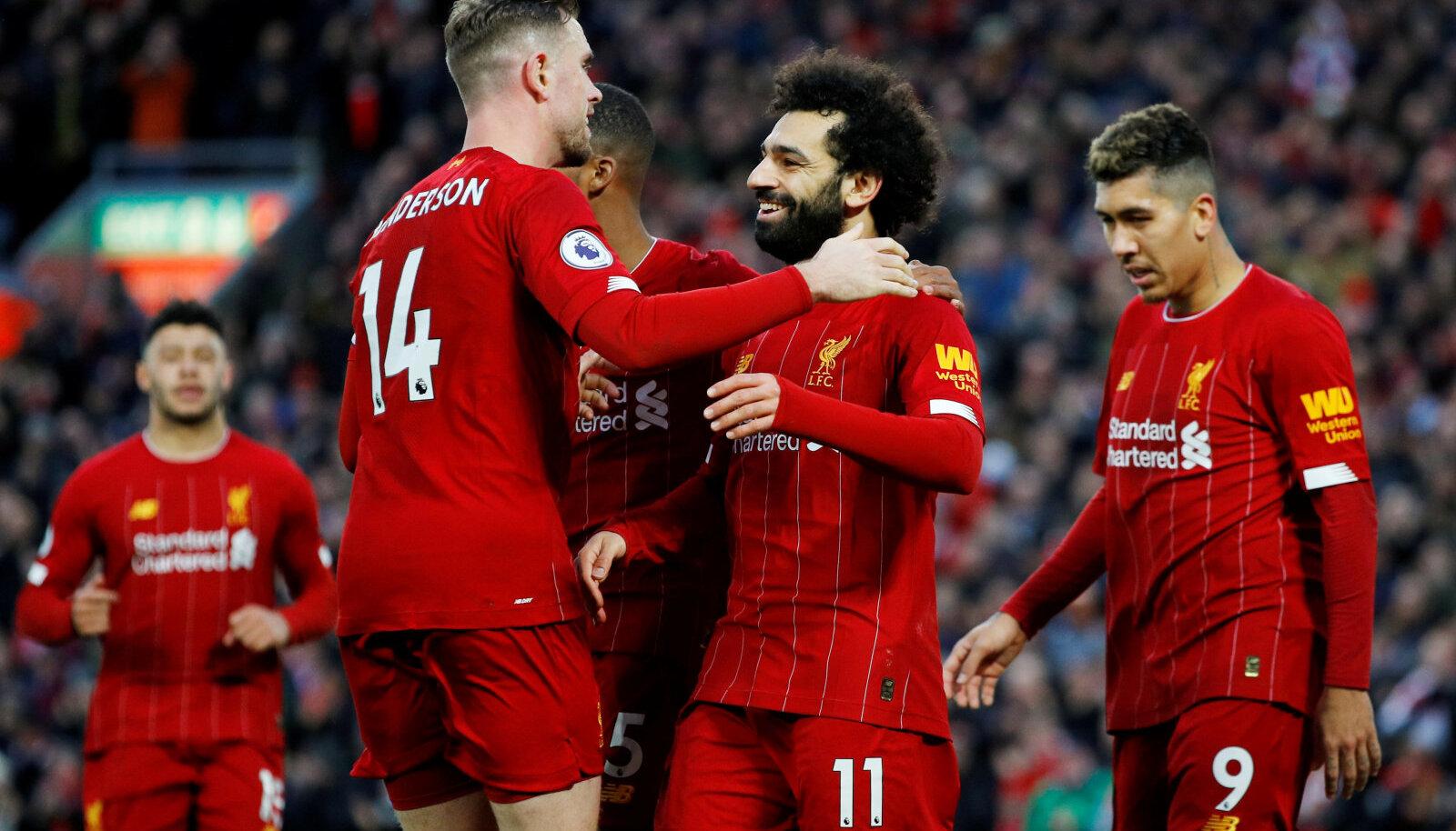 Liverpooli mängijad Jordan Henderson ja Mo Salah