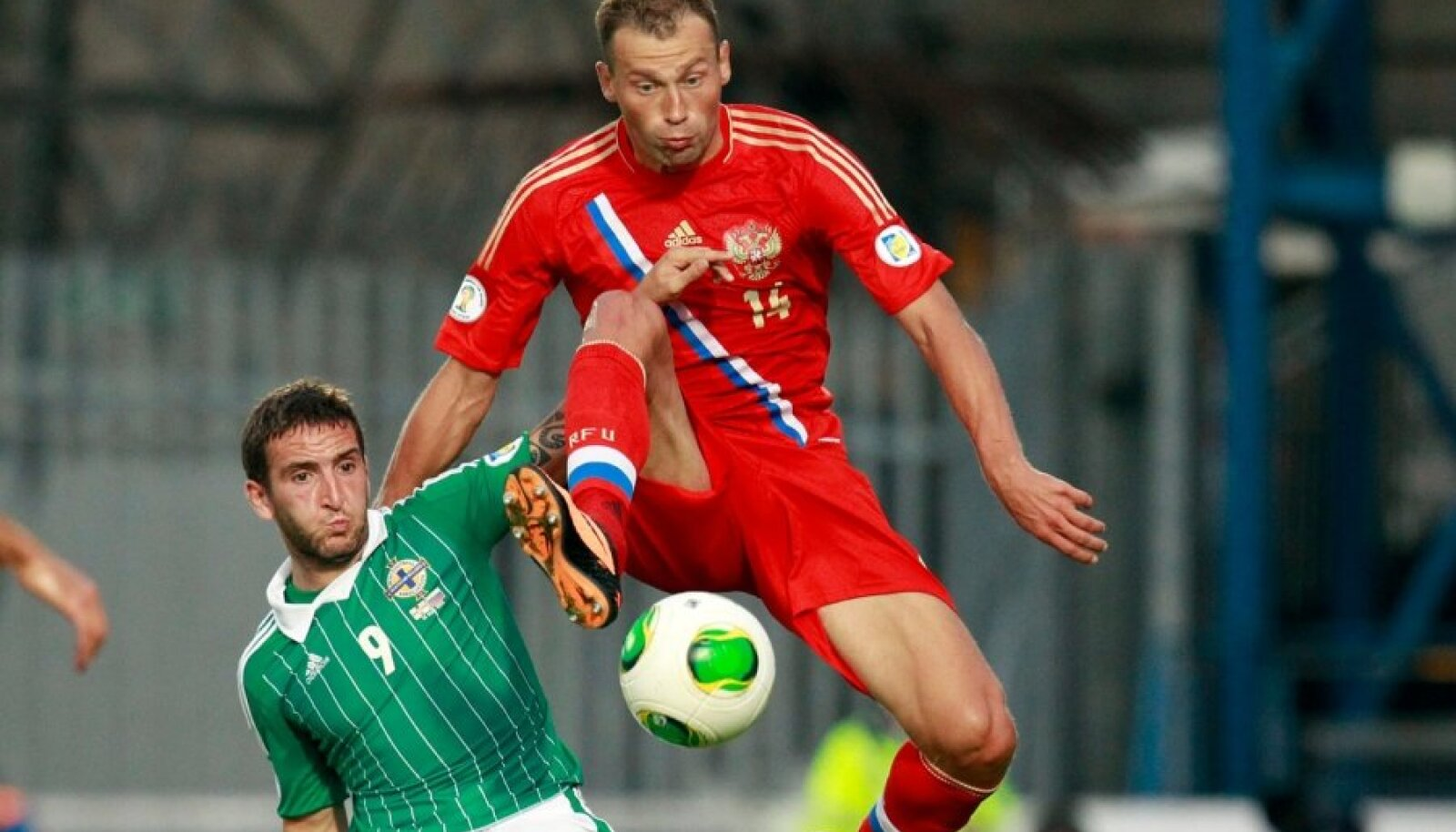 Northern Ireland's Martin Paterson is challenged by Russia's Vasily Berezutskyi during their World Cup qualifying soccer match at Windsor Park Stadium in Belfast