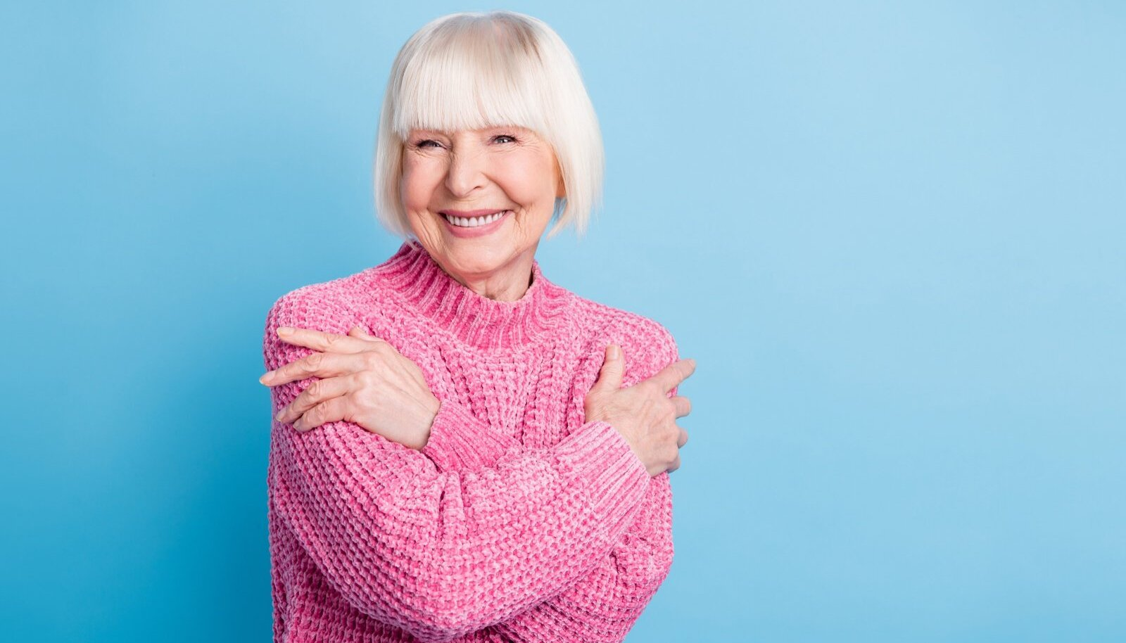 Photo,Portrait,Of,Old,Woman,Hugging,Self,Isolated,On,Pastel