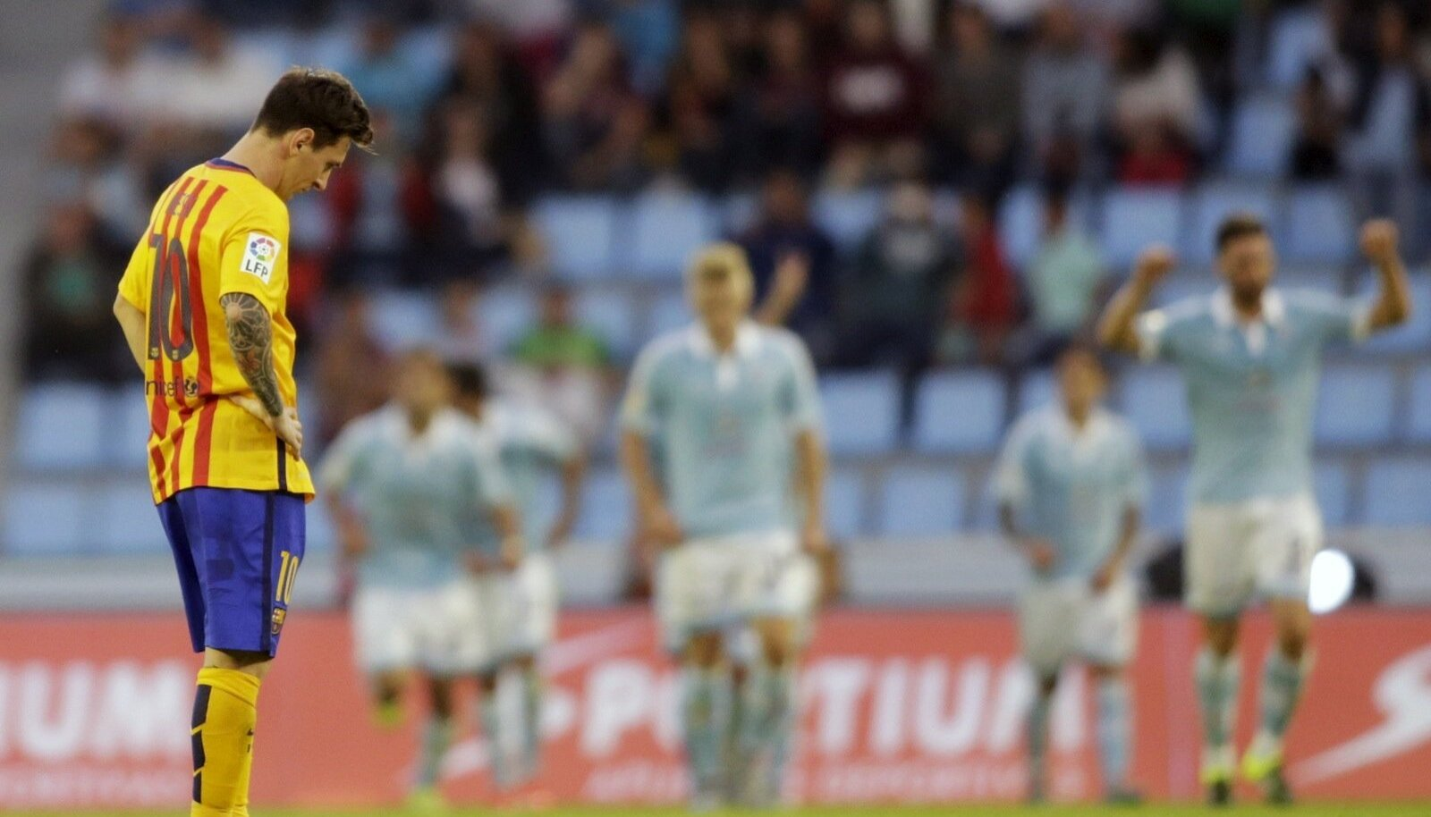 Barcelona's Messi reacts after a goal of Celta Vigo during their Spanish first division soccer match at Balaidos stadium in Vigo