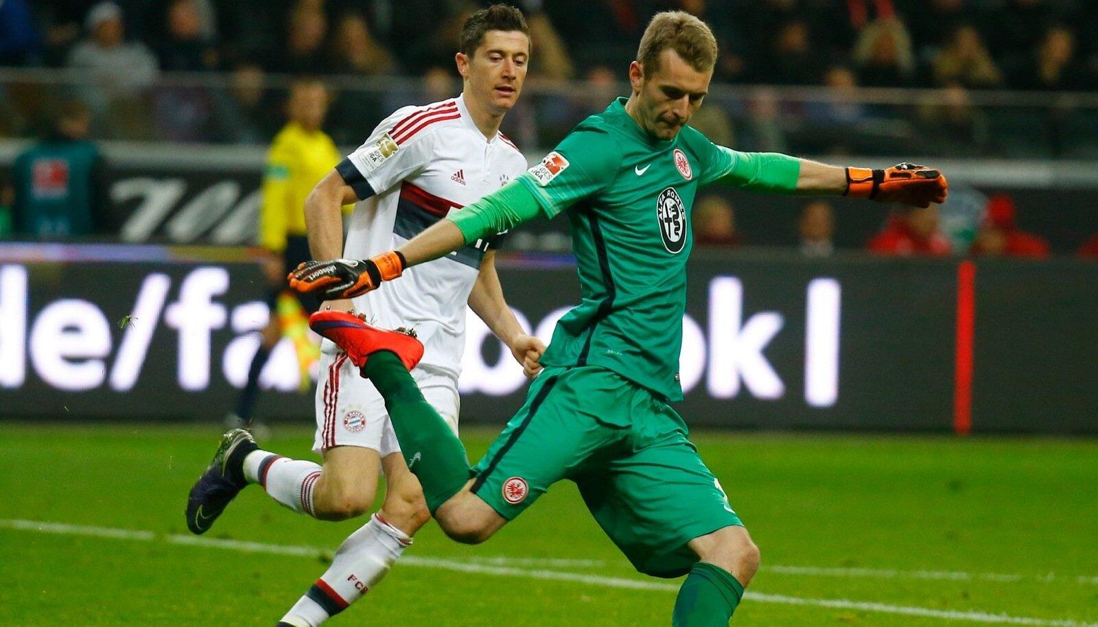 Eintracht Frankfur's Hradecky and Bayern Munich's Lewandowski fight for the ball during their German first division Bundesliga soccer match in Frankfurt