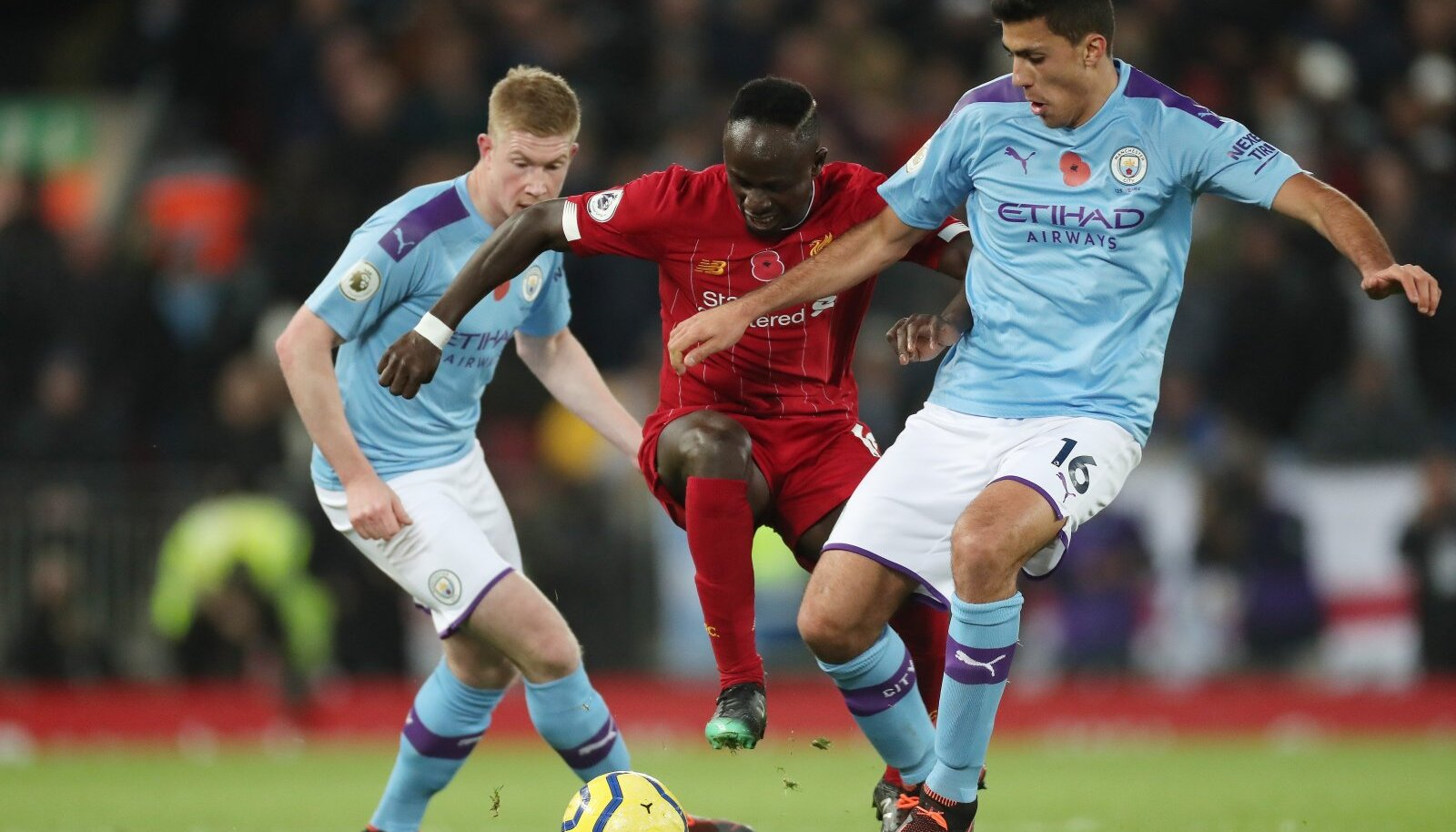 Football - 2019 / 2020 Premier League - Liverpool vs. Manchester City Sadio Mane of Liverpool competes with Rodri of Ma