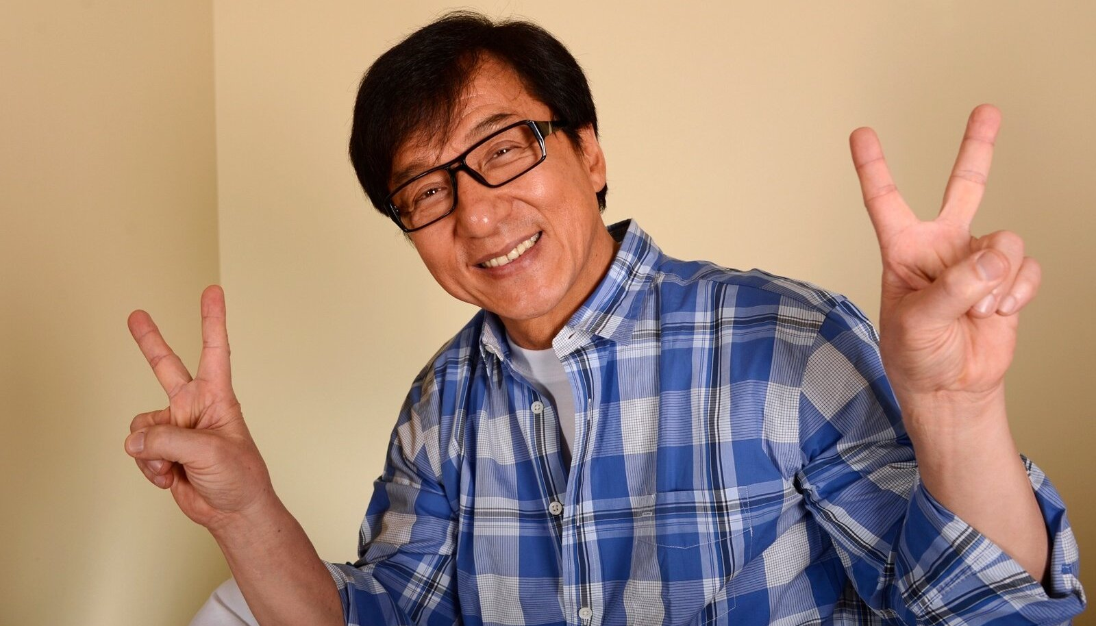 """Hong Kong actor Jackie Chan poses during a promotional event for his film """"Chinese Zodiac"""" in Beverly Hills"""