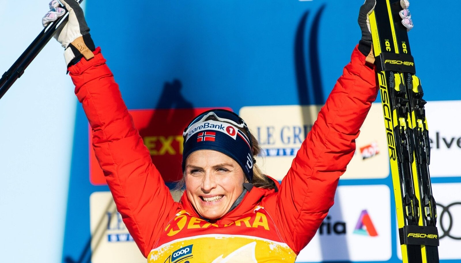 """200101 Therese Johaug of Norway celebrates on the podium after the women""""!s 10 km classic technique pursuit during Tour"""