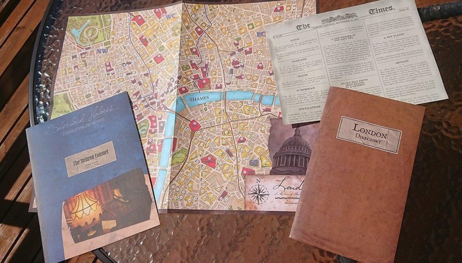 """JUURDLUS VÕIB ALATA: Kõik, mida läheb vaja """"Sherlock Holmes Consulting Detective'i"""" mängimiseks - Londoni kaart ja aadressraamat, tänane The Times ja juhtumibrošüür. Kõik peale viimase on veebist tasuta allalaaditavad."""