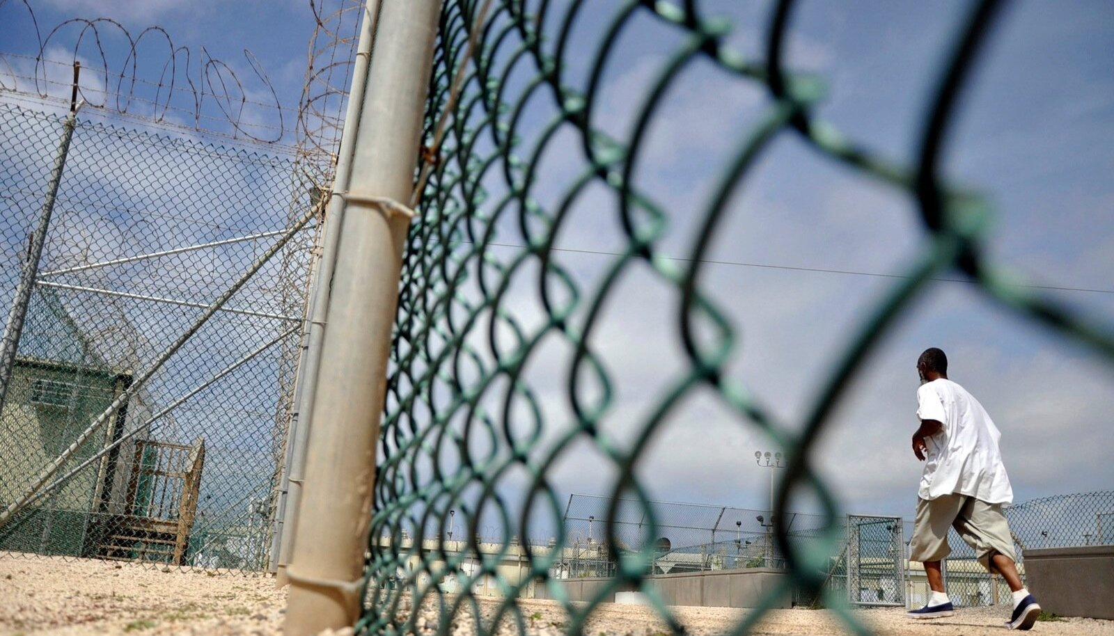 File picture shows a Guantanamo detainee running inside an exercise area at the detention facility at Guantanamo Bay U.S. Naval Base