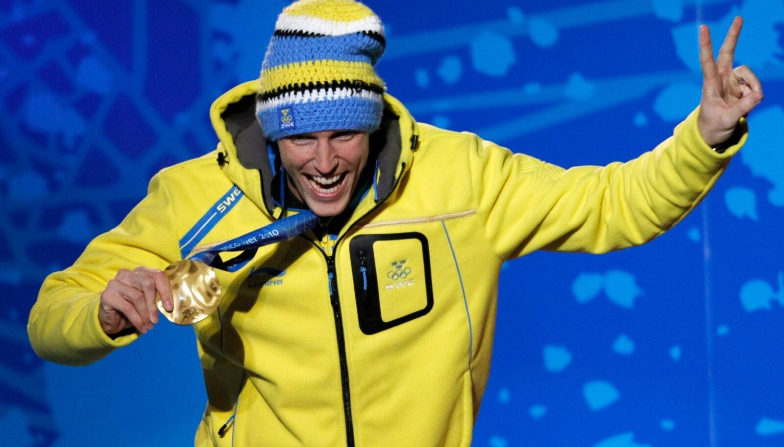 Gold medallist Ferry celebrates during the medal ceremony for the men's 12.5km pursuit biathlon competiton at the Vancouver 2010 Winter Olympics