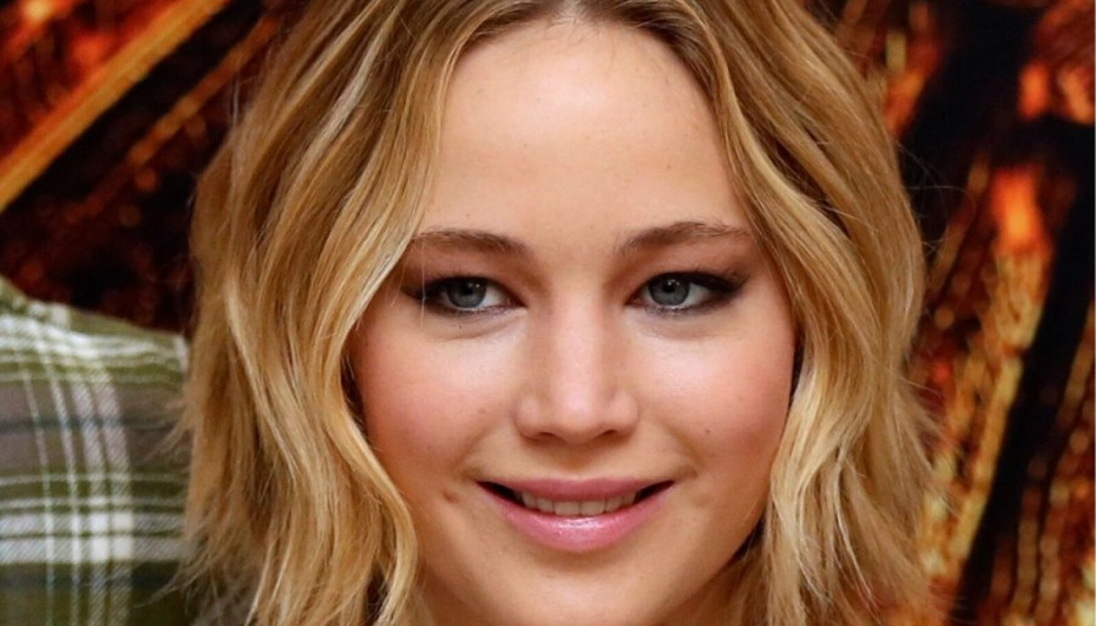 Actress Jennifer Lawrence attends the photocall for 'The Hunger Games: Mockingjay Part 1' in London
