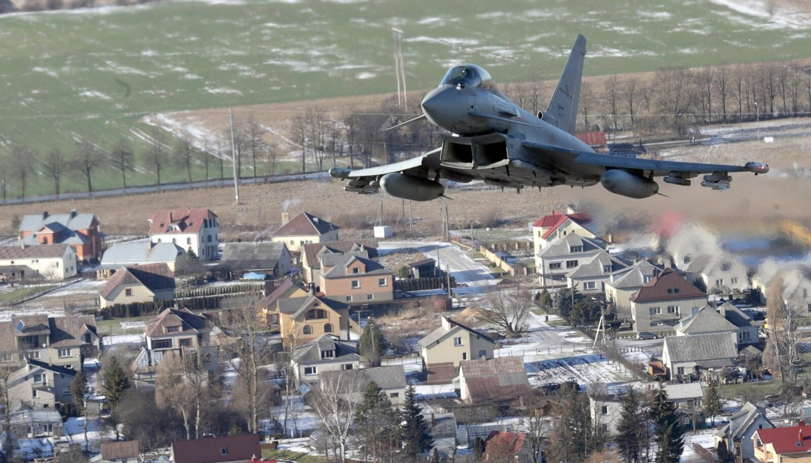 An Italian Air Force Eurofighter Typhoon fighter patrols over the Baltics during a NATO air policing mission from Zokniai air base near Siauliai