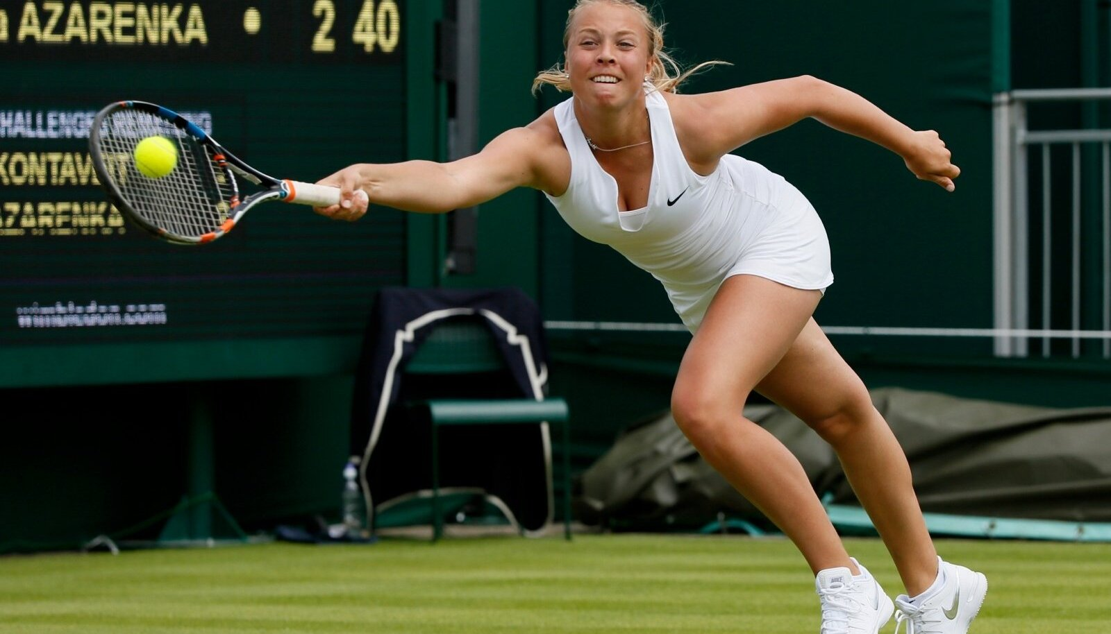 Anett Kontaveit of Estonia hits the ball during her match against Victoria Azarenka of Belarus. at the Wimbledon Tennis Championships in London