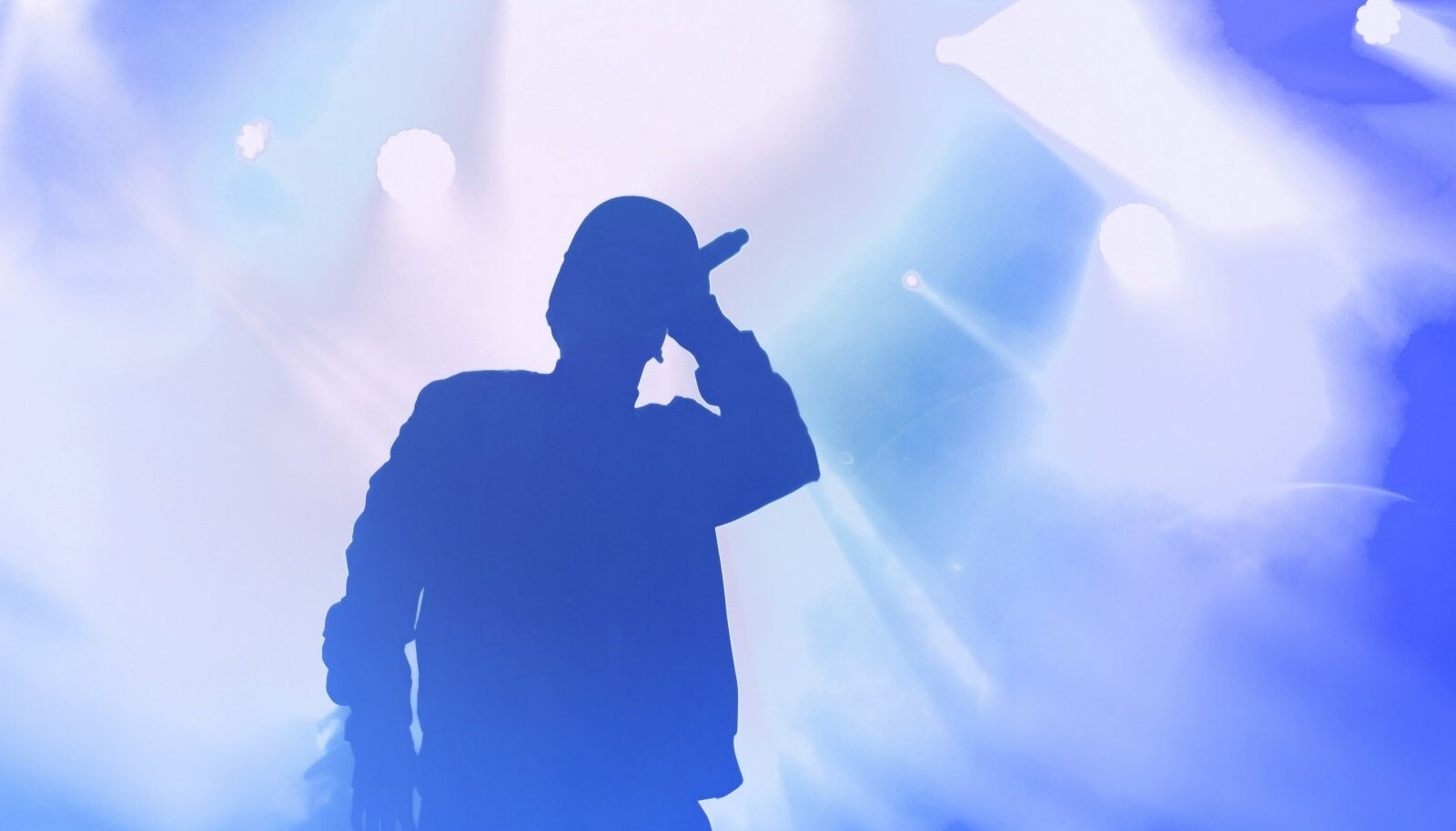 Stock,Photo,Of,Young,Rap,Singer,With,Mic,In,Hand