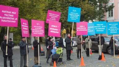 Small protest against civil partnership law near the parliament on Monday