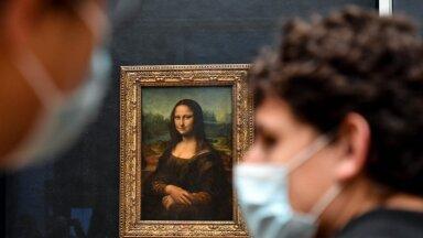 Külastajad imetlevad Pariisis Louvre'i muuseumis da Vinci üht tuntuimat taiest, Mona Lisa maali (foto: AFP / Scanpix)