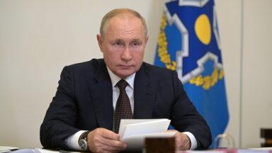 Vene president Vladimir Putin täna isolatsioonis videosilla vahedusel tööpostil.