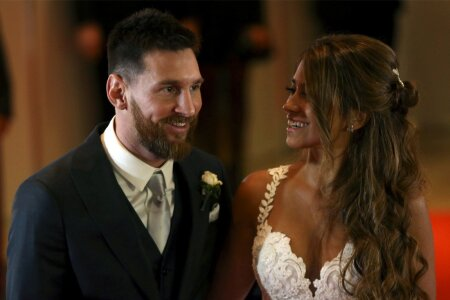 Argentine soccer player Lionel Messi and his wife Antonela Roccuzzo pose at their wedding in Rosario, Argentina